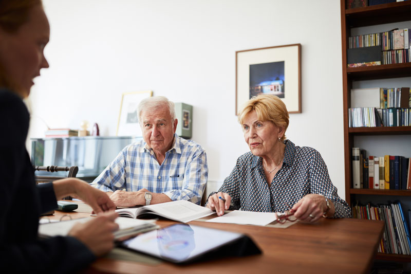 Senior couple filling out taxes