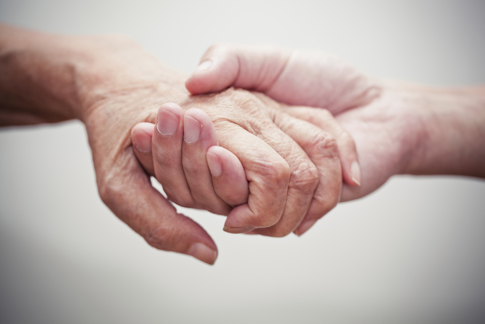 Holding hands | Adams County Office for Aging